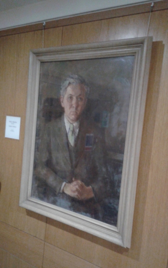 Portrait of Angus Wilson hanging near the entrance to Humanities 1 Reading Room British Library