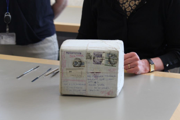A close-up of one parcel showing the shipping address and stamps.