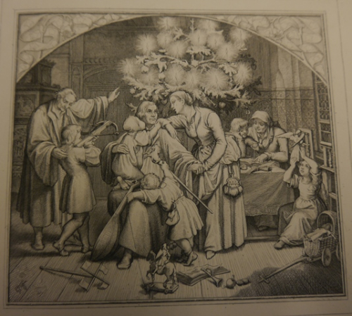 Luther and his family in front of a Christmas tree