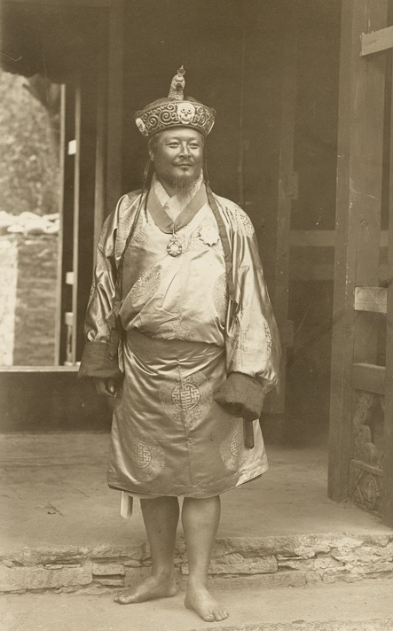 Photograph of Ugyen Wangchuk wearing the crown and traditional Bhutanese dress.