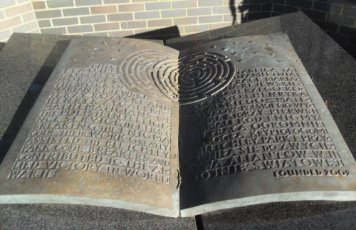 Bronze memorial to Polish mathematicians at Bletchley Park in the form of an open book