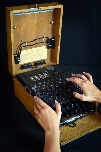 An original Enigma machine in its wooden case