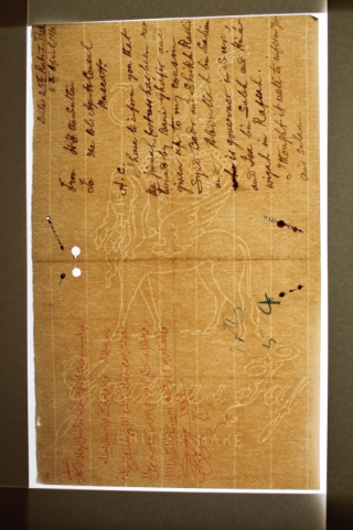 A page manufactured using laid and wove paper, which is revealed distinctively by transmitted light, showing the chain and wire lines on the paper. On the page itself can be seen a large central watermark of a Sphinx like creature with a crown between it's wings. On the left hand side of the page is arabic script in red, with text in black handwriting on the right hand side of the page.