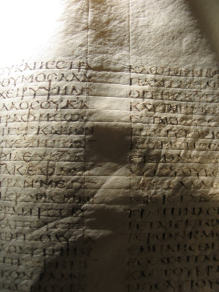 A page of the Codex Sinaiticus cast with raking light. This light has revealed the ruling lines, both horizontally and vertically, used to keep the text in place.