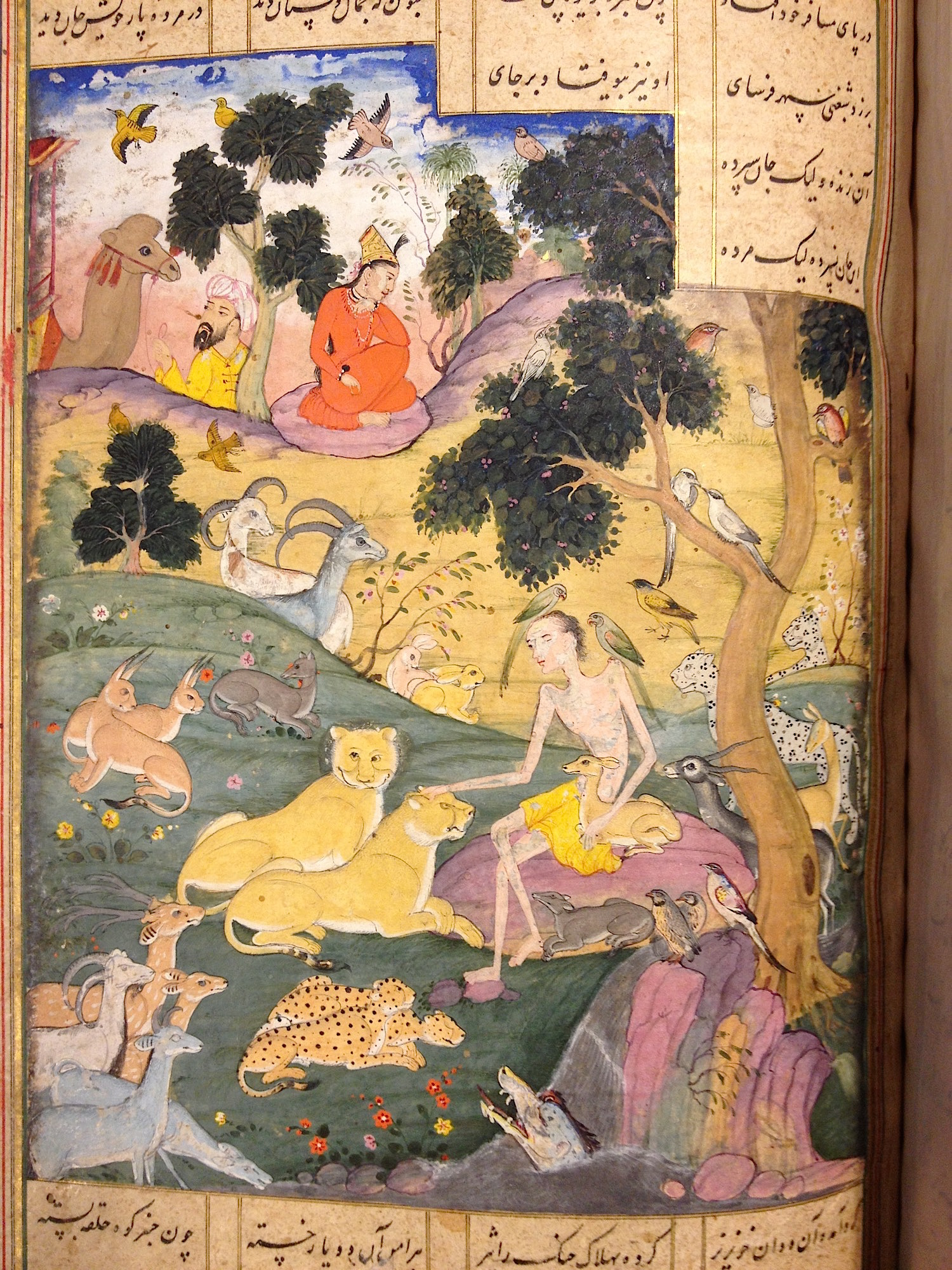 Layla visits Majnun in the wilderness surrounded by animals (IO Islamic 384, f. 42r) [Licensed under Public Domain]