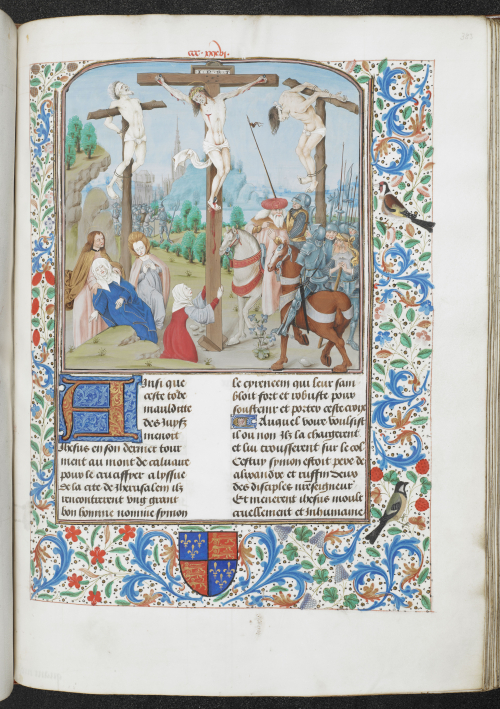 A page from a highly illuminated Bible, showing an illustration of Christ's death on the Cross.