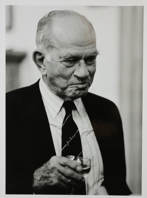 Photograph of Senator Fulbright holding a glass of wine