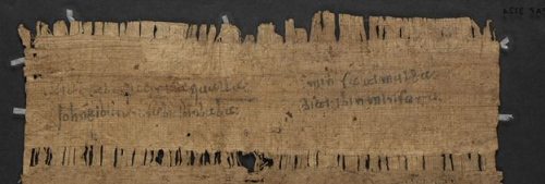 A detail from the back of a papyrus, showing the name of the author in Arabic.