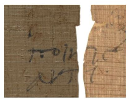 A marginal note in Ancient Greek running over from one part of a papyrus roll to another.