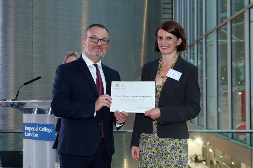 Dr Claire Breay receiving the inscription certificate for the Cotton collection from UNESCO Ambassador Matthew Lodge