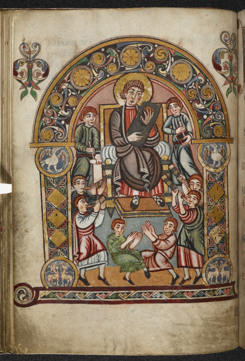 A page from the Vespasian Psalter, showing an illustration of King David surrounded by musicians and scribes.
