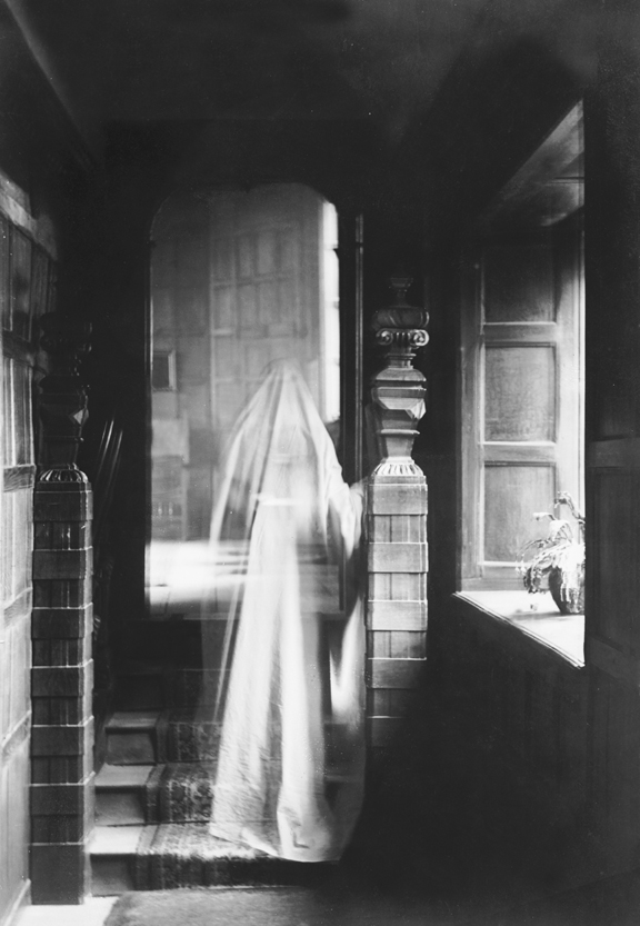 An image of a spectral figure walking up a staircase