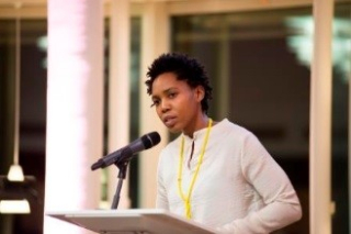Photograph of Omikemi Natacha Bryan giving speech