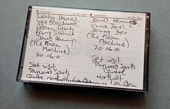 Photo of tape cassette from the Anwar Brett collection, with handwritten insert visible. This tape contains recordings made on the set of 'The Mean Machine', 20 June 2001