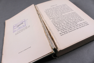 A book with its pages open, showing the detaching of pages from the text block and case.
