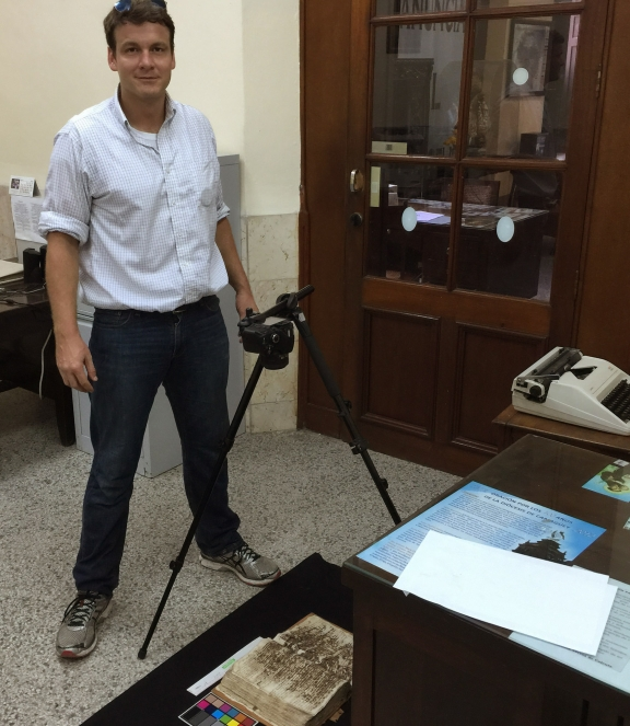 David LaFevor standing next to a tripod and digitising while in Cuba,
