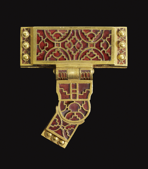 The scabbard slider and strap distributor from the Sutton Hoo sword-belt