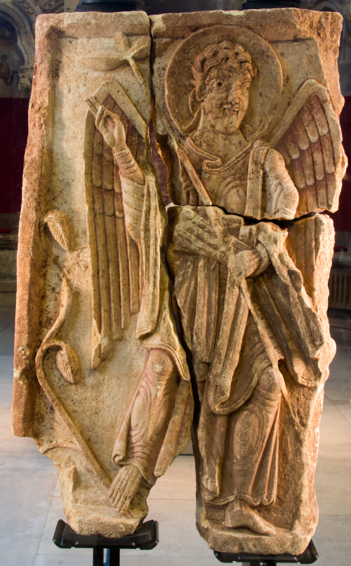 A stone sculpture of a winged angel.