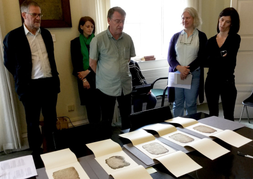 Workshop participants examining fragments of a medieval manuscript.