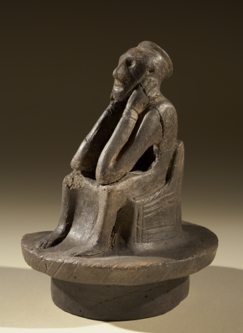 Spong Man, an Anglo-Saxon urn lid in the shape of a seated figure.