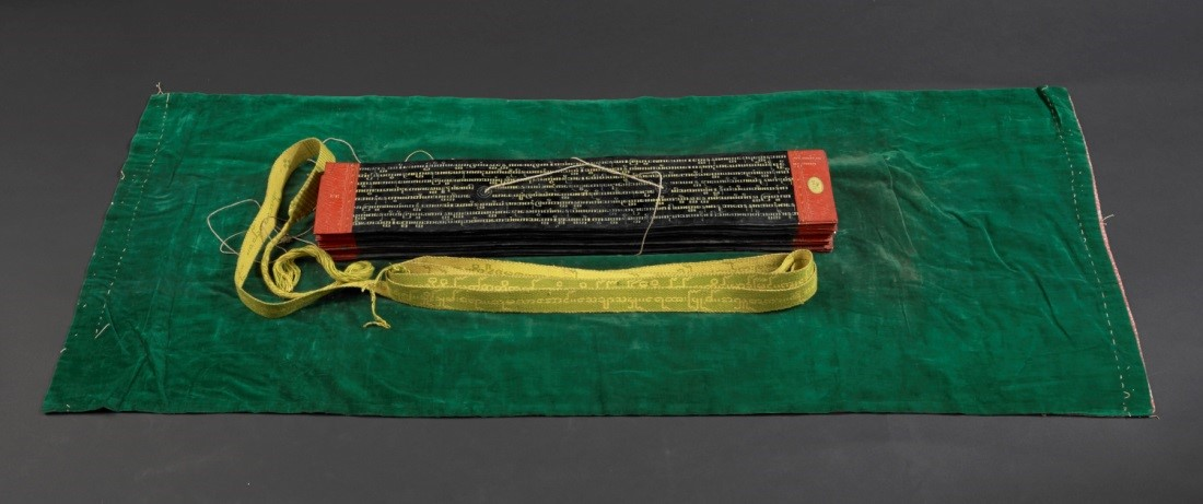 This manuscript, written in Pali – the canonical language of Theravada Buddhism – in yellow Burmese square characters, is inscribed on 49 palm leaves coated with lacquer. It contains fragments of Atthakathas, or commentaries on the Tipitaka. The manuscript is bound up with a green velvet wrapper and a ribbon, or sazigyo. Burma, 19th century. Credit: British Library, Or 3672