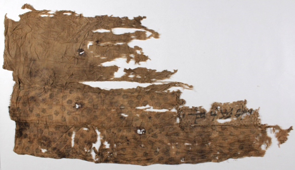 The obverse of the Silk bundle after conservation. The repeated printed pattern can be seen more clearly on this side.