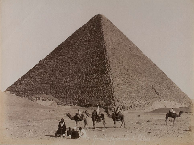 A caravan of camels in front of one of the pyramids in Egypt.