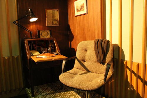 Chair, desk and lamp in the set of Dear John