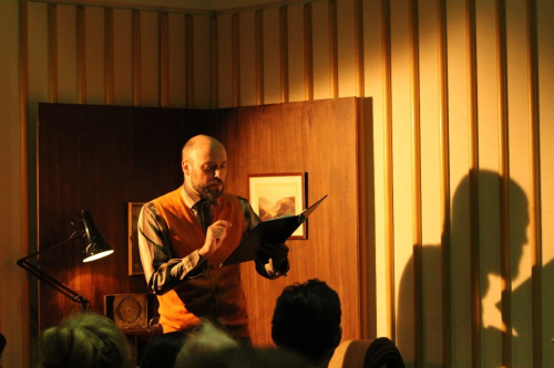 Neal Craig reading in the performance