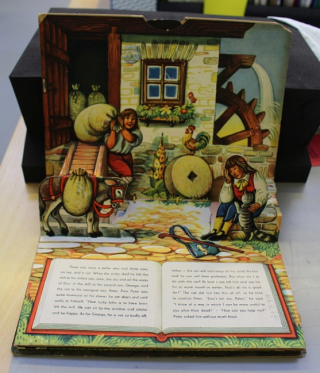 A shot of the inside of the Puss In Boots pop up book showing the paper repair complete