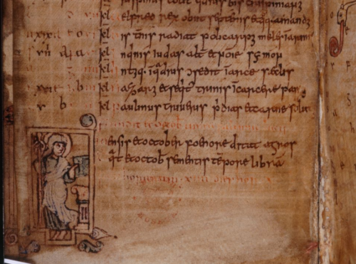 A detail of a calendar page from the Galba Psalter, showing an illustration of a saint holding a book.