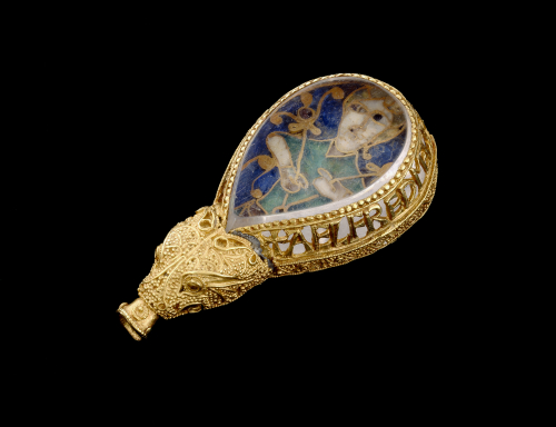 The Alfred Jewel, a enamel plaque of a man holding flowering rods, encased in quartz and framed in gold