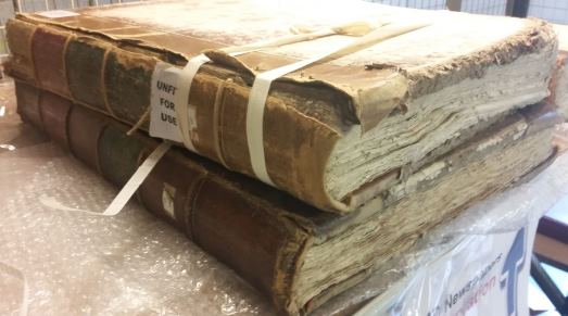 Unfit newspaper volumes awaiting conservation inspection at the British Library