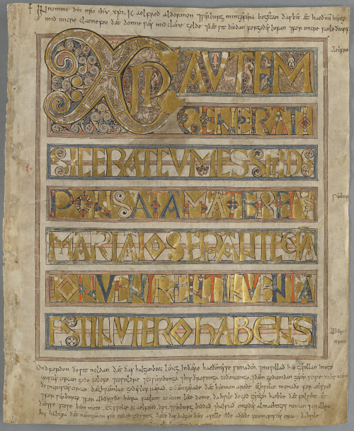 A page of text written in gold capital letters, beginning with the Chi-rho, the monogram of the Greek name of Christ. In the lower margin is a later inscription.