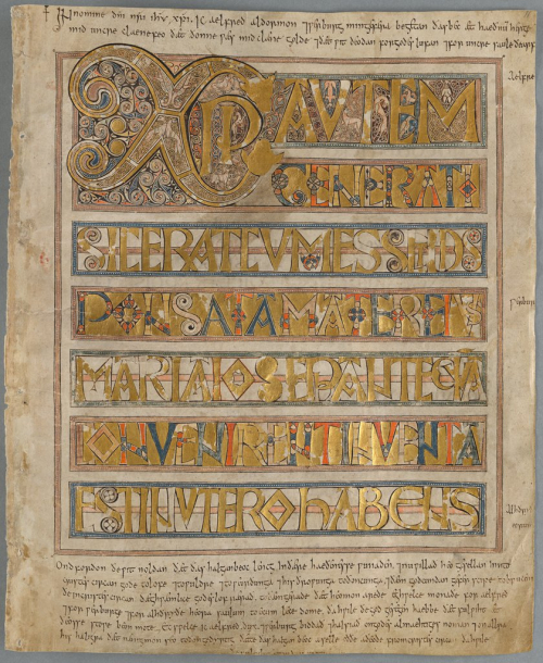 A page from the Codex Aureus, showing the text of the Gospels written in gold, with an added Latin inscription above and below the main text.