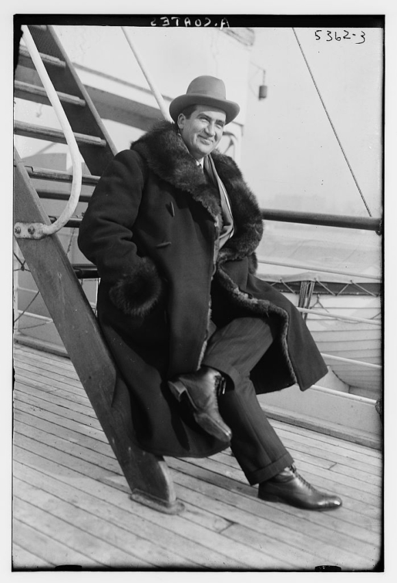 Albert_Coates_(musician)_circa_1920_on_a_boat_with_legs_crossed