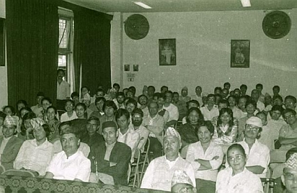Black and white photograph showing an attentive audience.