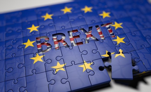 Brexit image over EU flag on a jigsaw puzzle