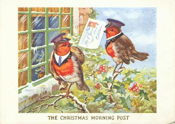 A Christmas card featuring a pair of robins from 1934