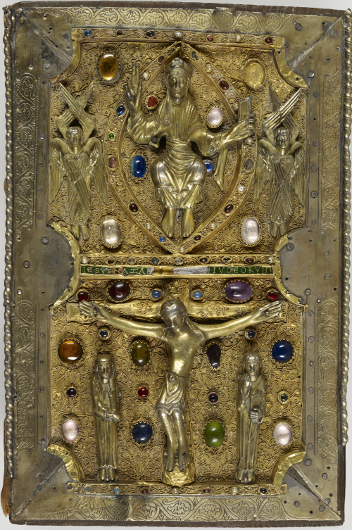 An ornate gold book cover, showing the crucifixion in the lower half and Christ in Majesty above