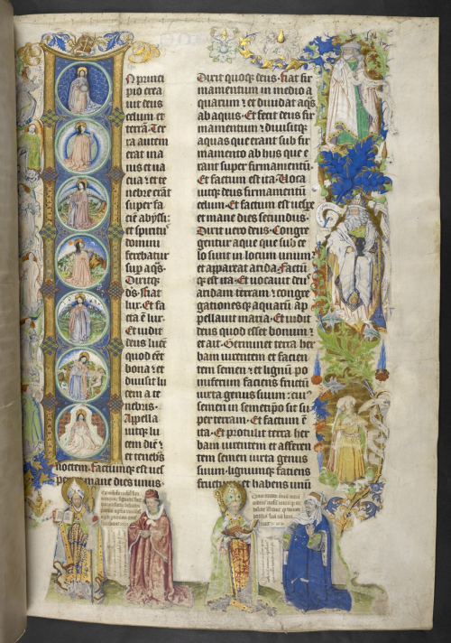 The opening page of a Bible text with an elaborate decorated intial and figures in the margins