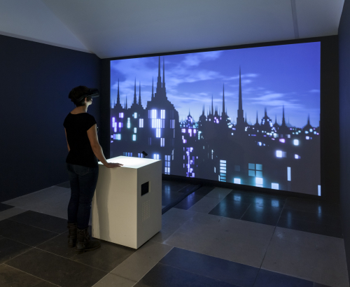 Female wearing VR headset in Imaginary Cities Exhibition