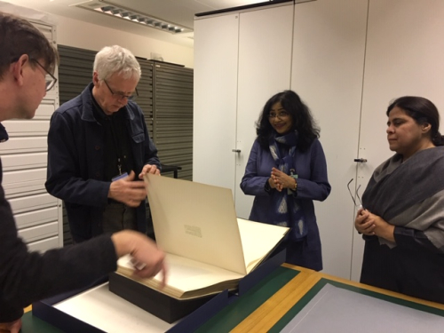Photograph showing John Falconer (British Library), Vandana Sinha (CA&A) and Purnima Mehta (AIIS) looking at photographic collections.