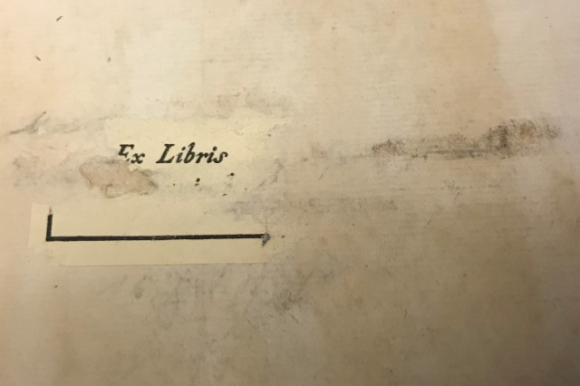 Scratched out ex-libris of Monsieur Jean Furstenberg on the front pastedown of Davis 874