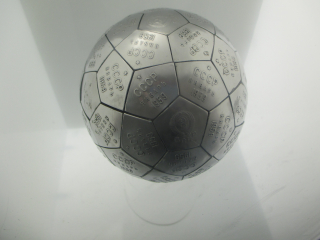 A policed metal globe of tesellating pentagons, each marked CCCP 1959