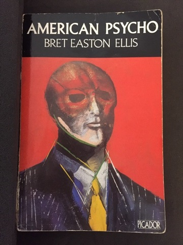 Cover illustration of man in mask on American Psycho by Bret Easton Ellis (published by Picador in 1991)