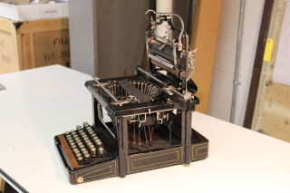 Side view of Victorian typewriter