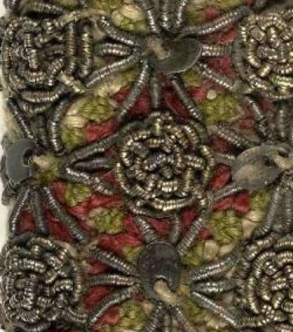 A close up of a 16th century embroidered binding.