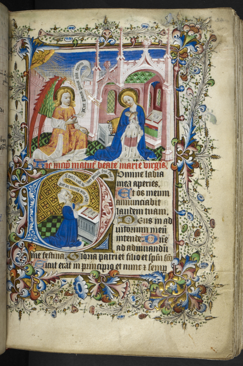 A decorated page with a picture of the Virgin Mary and the Angel Gabriel, and below inside the decorated intial, a picture of a woman praying