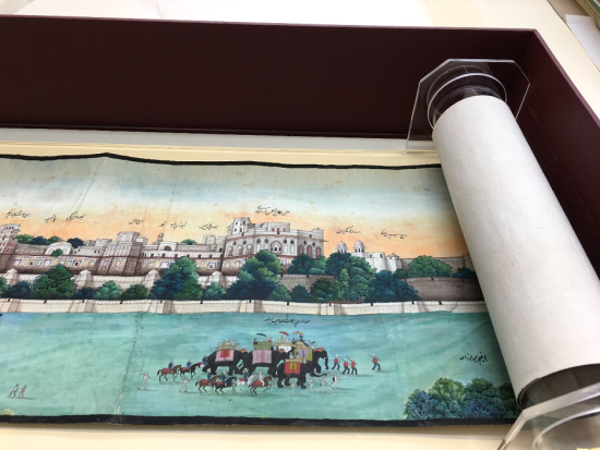 The scroll in the new roller open on an image of an entourage of people and elephants